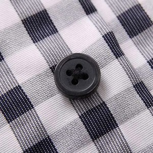 Пример ткани рубашки в черно-белою клетку